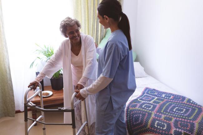 Senior resident at nursing home with nurse